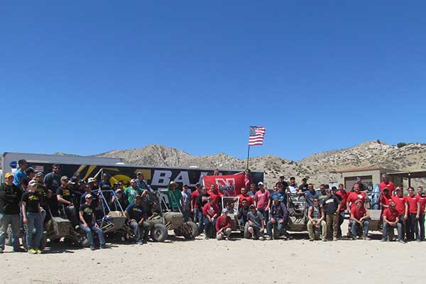 The Husker Racing Baja SAE team (center with flag) was one of six teams from Big Ten schools at last weekend's event in Gorman, California. Other teams (from left) were from Iowa, Michigan, Michigan State, Purdue and Wisconsin.