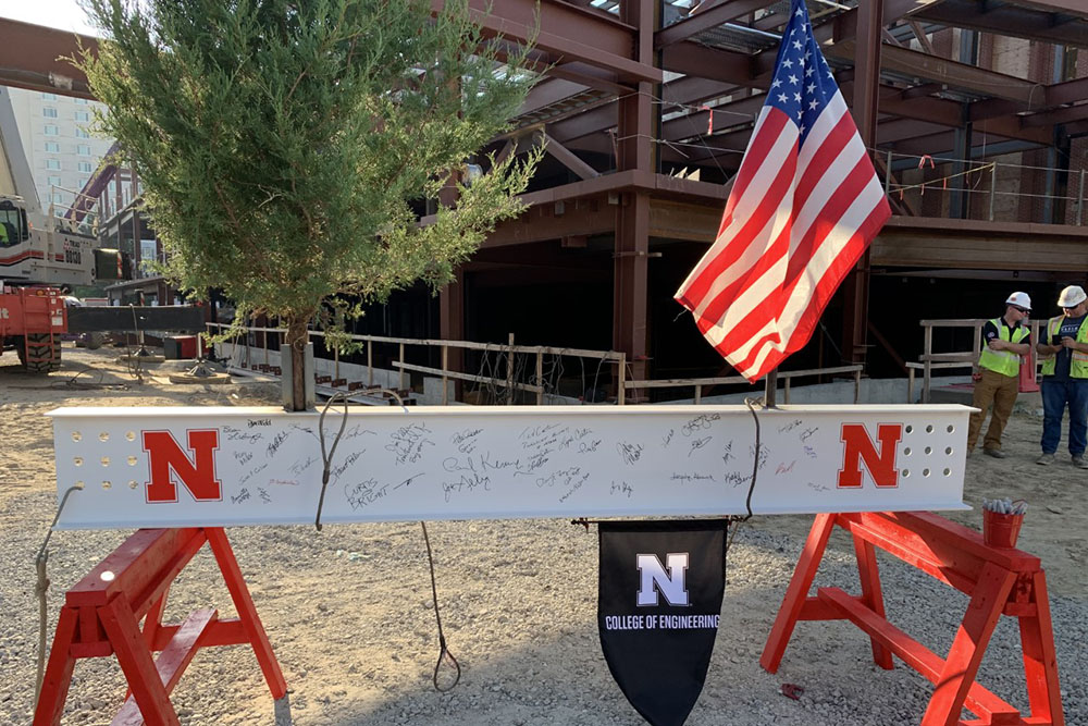 After many signatures were inscribed on the final steal beam, it was raised into place during Wednesday's Topping Out ceremony.
