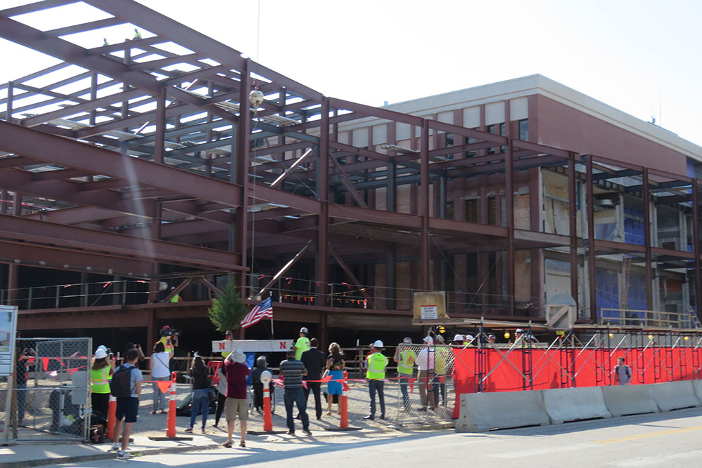 A small crowd gathers for the Topping Out ceremony for Phase 1 of the college's construction project.