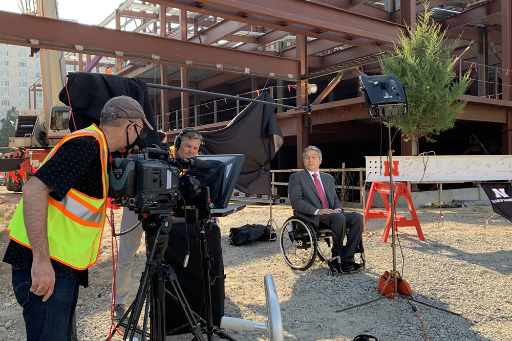 College of Engineering Dean Lance C. Pérez records a video message before the Topping Out ceremony for Phase 1 of the college's construction project.