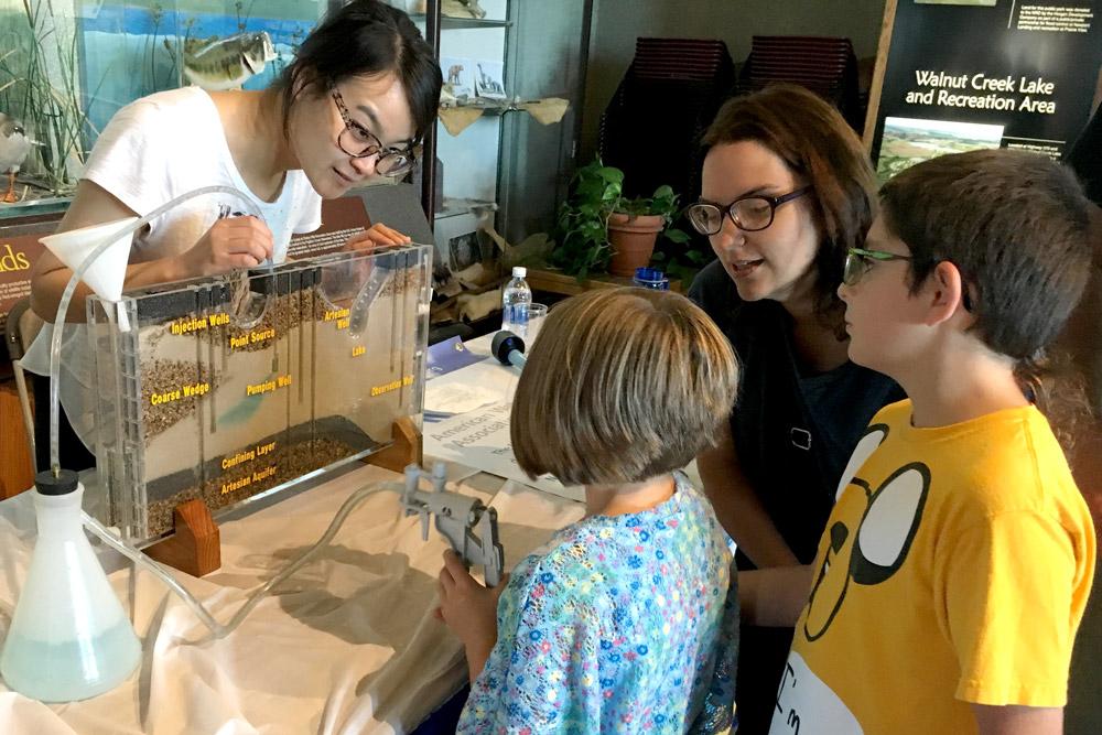 Yutian Lei demonstrates the water pump
