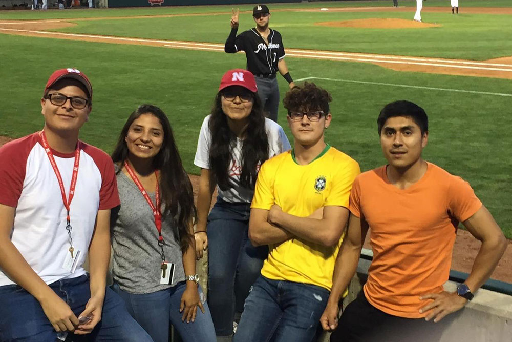 Yachay Tech students (from left) Carlos Brito, Selena Tinoco, Evelyn Mollocana, Fernando Pesantez and Francisco Quinga take in a Lincoln Saltdogs baseball game.