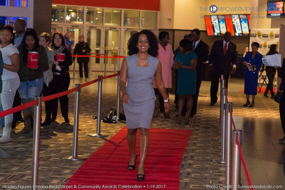 "Alisa Gilmore, associate professor of practice in electrical and computer engineering, walks the red carpet at Aksarben Cinema before the Jan. 19 screening of ""Hidden Figures."""