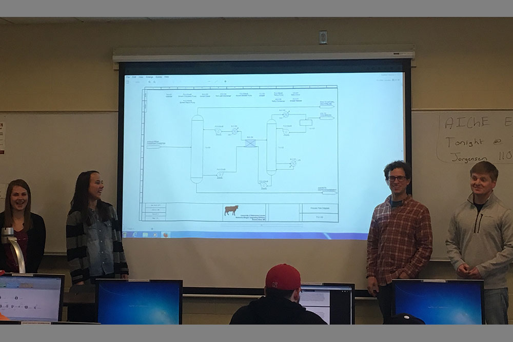 A team of chemical and biomolecular engineering students -- from left (Heather Newell, Meryl Bloomfield, Dave Hansen and KJ Hafer) -- present their proposed Nebraska Biogas Upgrading Refinery during a senior design capstone class.