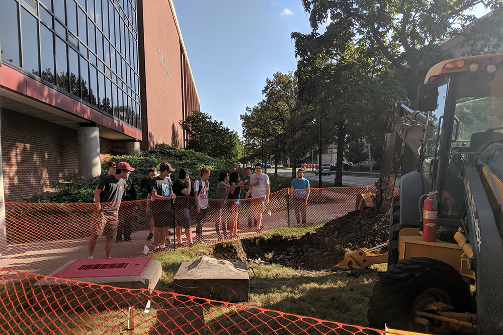 Students gather outside the Scott Engineering Center Link before the time capsule is unearthed.