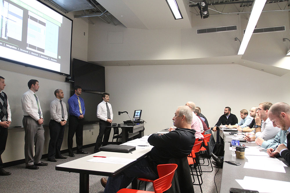Members of the Durham School team present their project to mentors and evaluators as part of the Architectural Engineering 8030-8040 Interdisciplinary Team Design Project classes in the senior capstone sequence.