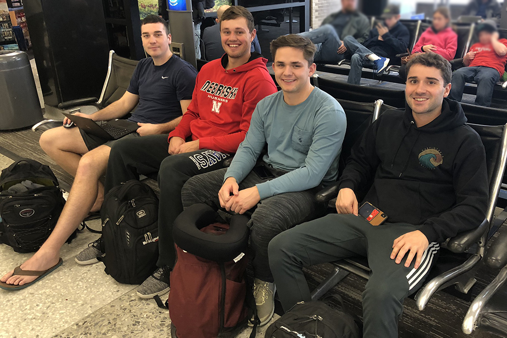 The Durham School construction student team of Zach Barnhill, Brad Hurtz, John Pupkes and Brady Standage waits to take off from the Lincoln Municipal Airport to begin their trip to Manchester, England.