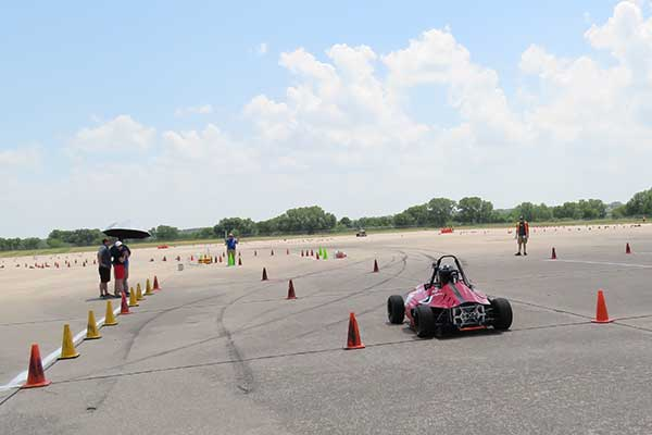 The Husker Motorsports Formula SAE car takes off to begin its autocross run on Friday at Lincoln Airpark.
