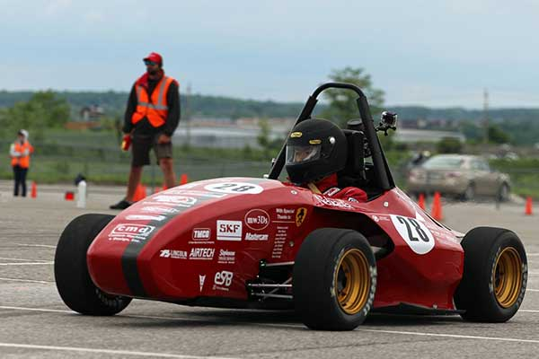 The Husker Motorsports car races around the track during the endurance event in Barrie, Ontario. After a ninth-place overall finish, the team of UNL engineering students is looking forward to a big finish at this week's event at Lincoln Airpark.