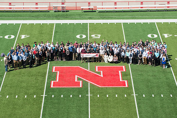More than 200 senior design capstone students and engineering faculty gathered at midfield for a photo before the Senior Design Showcase on April 22 at Memorial Stadium.