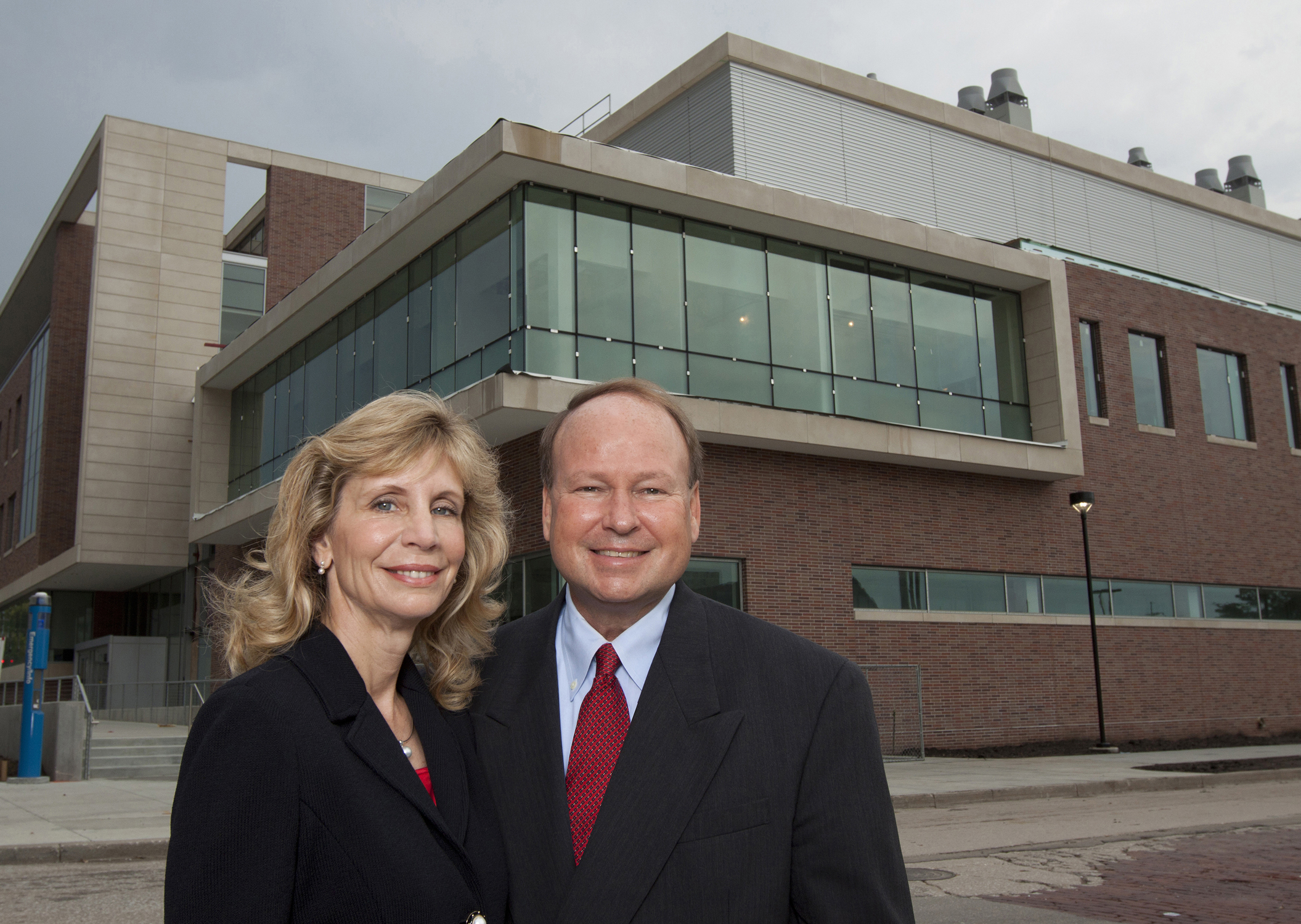Nancy Keegan and Don Voelte, '75 CIVE, stand outside the newly dedicated Voelte-Keegan Nanoscience Research Center at UNL.