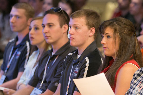 Members of the UNL MESC team - (from left) Peter Niechwiadowicz, Sarah Drummey, Adam Crnkovich, Tim Drake and Rose Gensichen - listen to a speaker March 22 during the MCAA conference in Orlando, Florida.