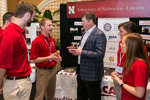 MCAA president Steve Dawson (center) talks with UNL construction management major Peter Niechwiadowicz and members of the MESC student chapter during the MCAA conference in Orlando, Florida.
