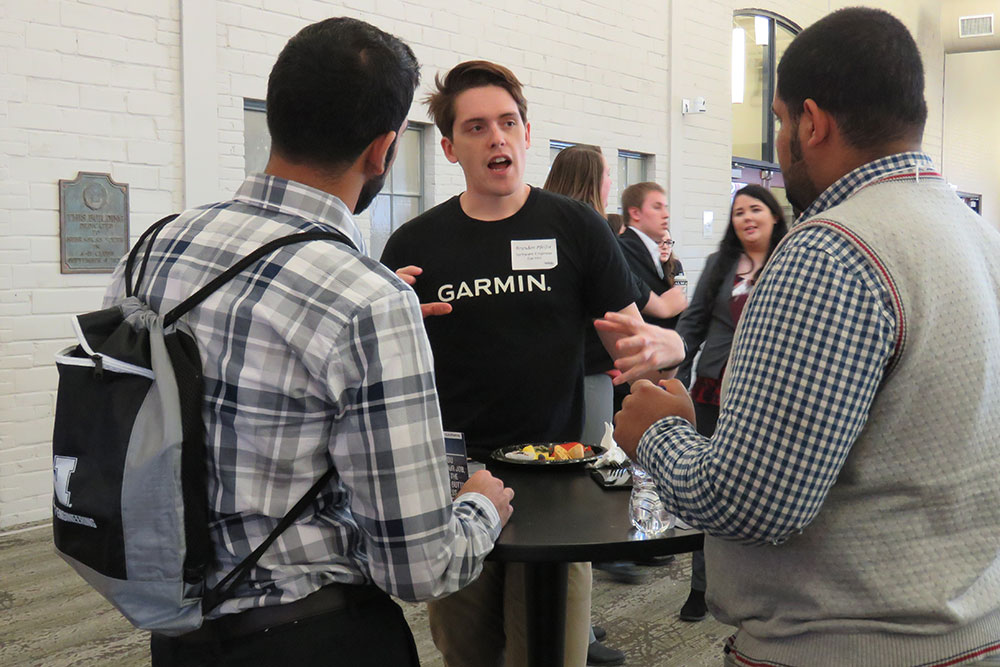 At the Complete Engineer mixer, Computer Engineering alumnus Brandon Pfeifer talks to engineering students after leading a workshop session Friday, March 2 at Nebraska Innovation Campus.