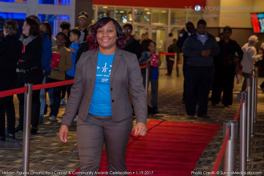 "Terri Norton, associate professor of construction engineering, walks the red carpet at Aksarben Cinema before the Jan. 19 screening of ""Hidden Figures."""