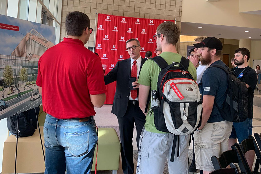 Ronnie Green, the University of Nebraska-Lincoln chancellor, talks with Nebraska Engineering students about the new Kiewit Hall after Monday's press conference in the Othmer Hall lobby.