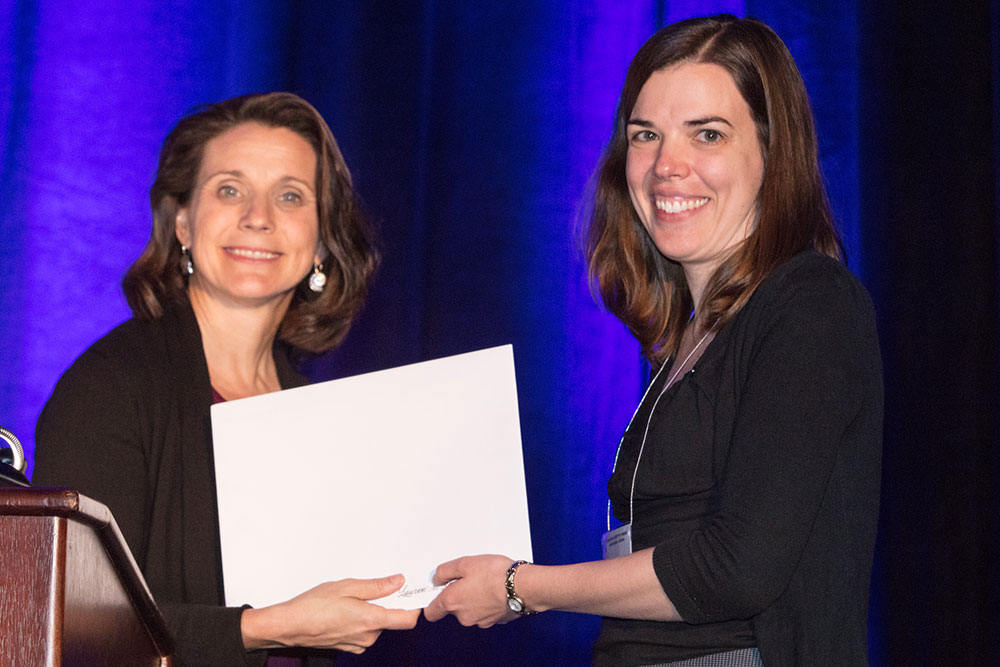 Lauren Ronsse (right), industry fellow at The Durham School of Architectural Engineering & Construction, receives the 2017 Science Writing Award for Professionals from Marcia Isakson, president of the Acoustical Society of America.