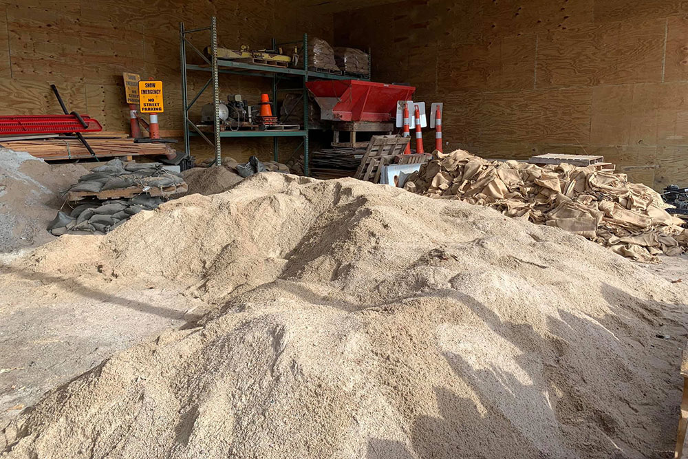 Tons of sand are piled up in a building in Waterloo, ready for volunteers to start making sandbags that would be used to bolster the levee along the Elkhorn River.