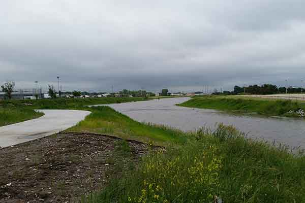 In early June, Antelope and Salt Creeks are at near flood stage where they meet north of the Devaney Sports Center.