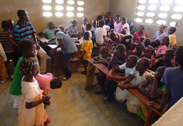 Children file into a new classroom at Flower of Hope.