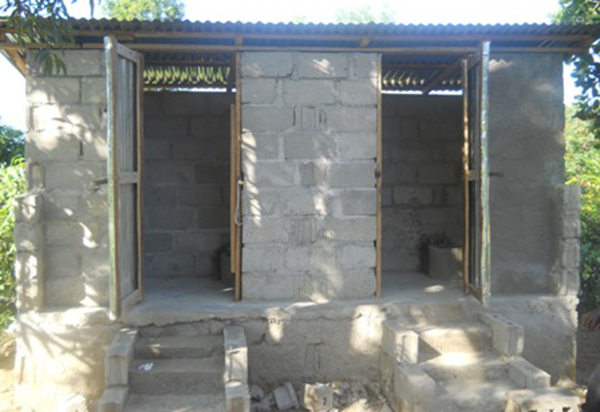 A new composting latrine is built for the children and teachers of Flower of Hope school.