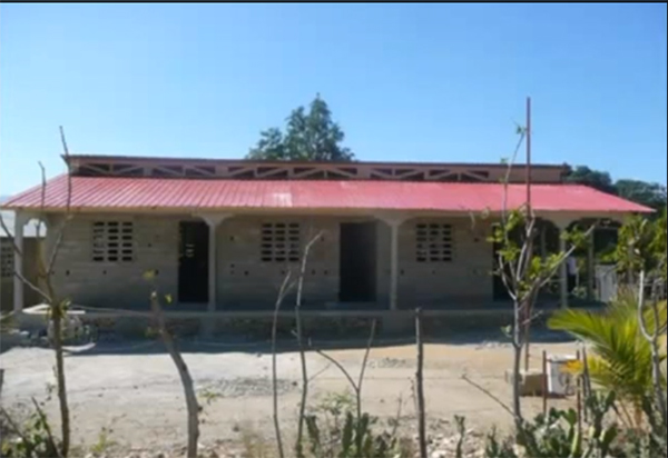 Except for the plastering of interior walls, construction of the new Flower of Hope school is completed.