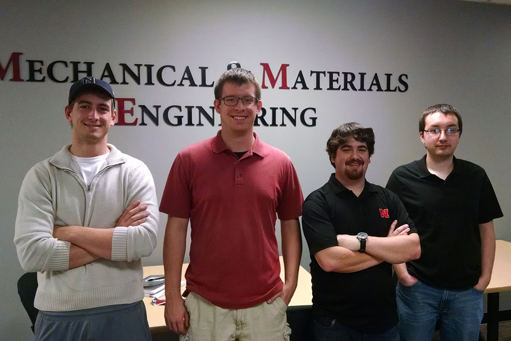 Mechanical engineering students (from left) Kyle Stewart, Alex Drozda, Colton Bailey and Tory Weeder designed a robot to automate the drilling process for airliner construction for both their senior design capstone project and the Airbus Shopfloor Challenge in Stockholm, Sweden.