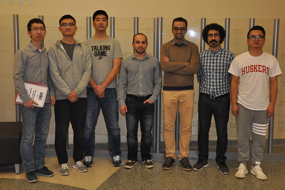 Among the graduate students honored in the poster competition were Dongyue Xie (far left, second place),  Fei Wang (third from left, third place) and Amir Monemian Esfahani (third from right, first place).