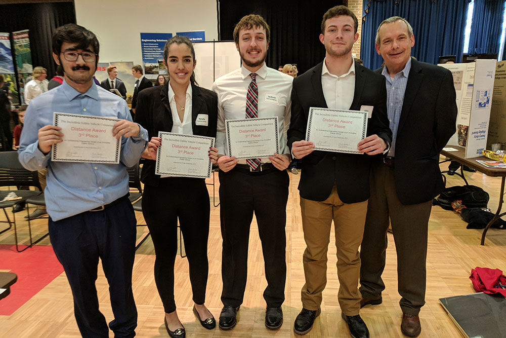 "David Jones (right), chair of biological systems engineering, presents the distance third place award to ""Dilly Dilly"" (team members Raghavendra Singh Raghuwanshi, Jackson VanLaningham, Adan Redwine and Natalia Cordona)."
