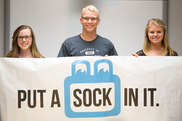 Put A Sock In It, founded in February by (from left) Josie Jensen, mechanical engineering major Tayler Sundermann and electrical engineering major Sarah Porath, has distributed more than 3,000 pairs of used socks to people in need. (Julian Tirtadjaja / Daily Nebraskan)