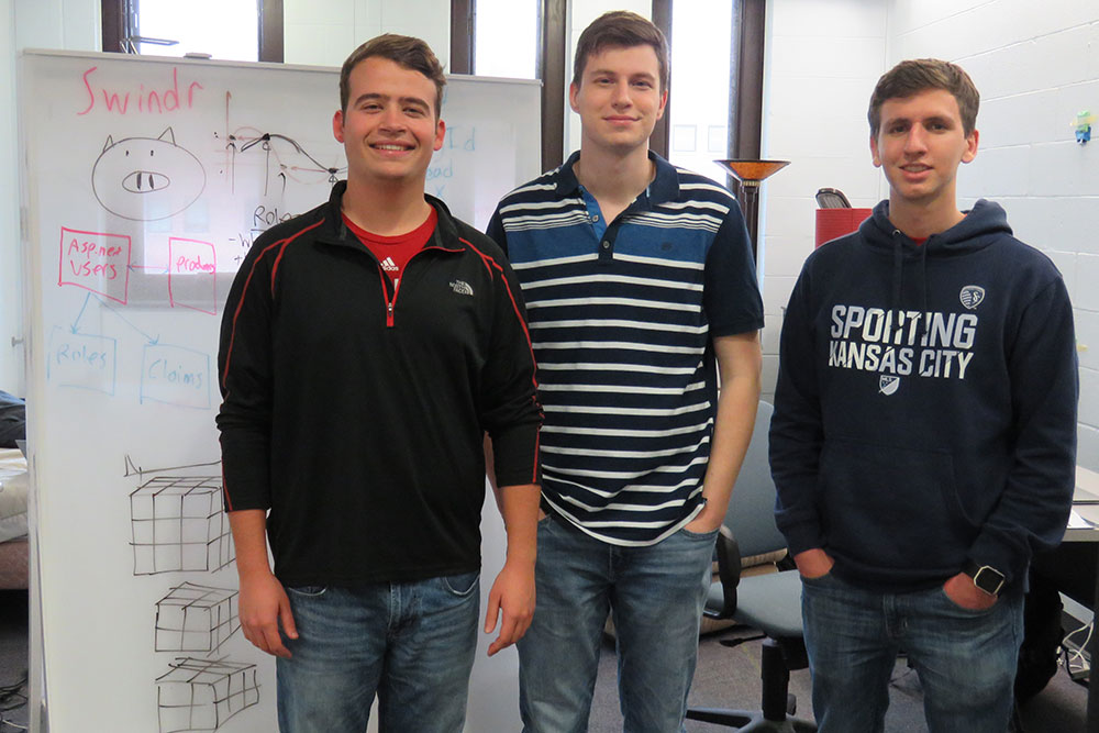 Team SWINDR - (from left) computer science major Keith Jett, computer engineering major Levi Hassel and computer science majors Alec Skinner and Justin Collier (not picutred) -- is working on an application that will allow farm workers to use 3-D camera technology to monitor the health of individual pigs in livestock pens.