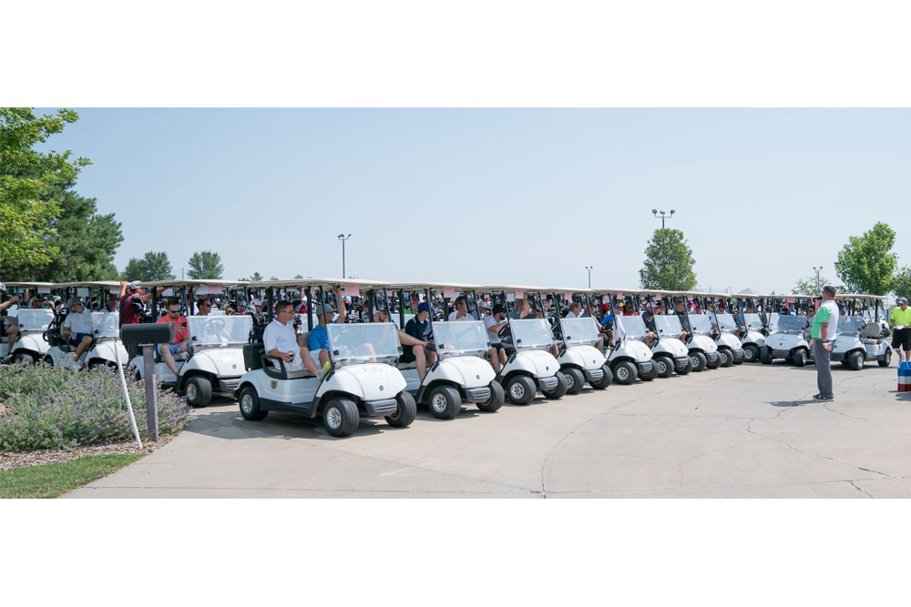 More than 60 teams with nearly 250 construction industry professionals listen to instructions as they await the signal to take their carts to their assigned tee boxes before the 15th annual Tradition of Excellence Golf Tournament on July 10 at Tiburon Golf Club in Omaha.