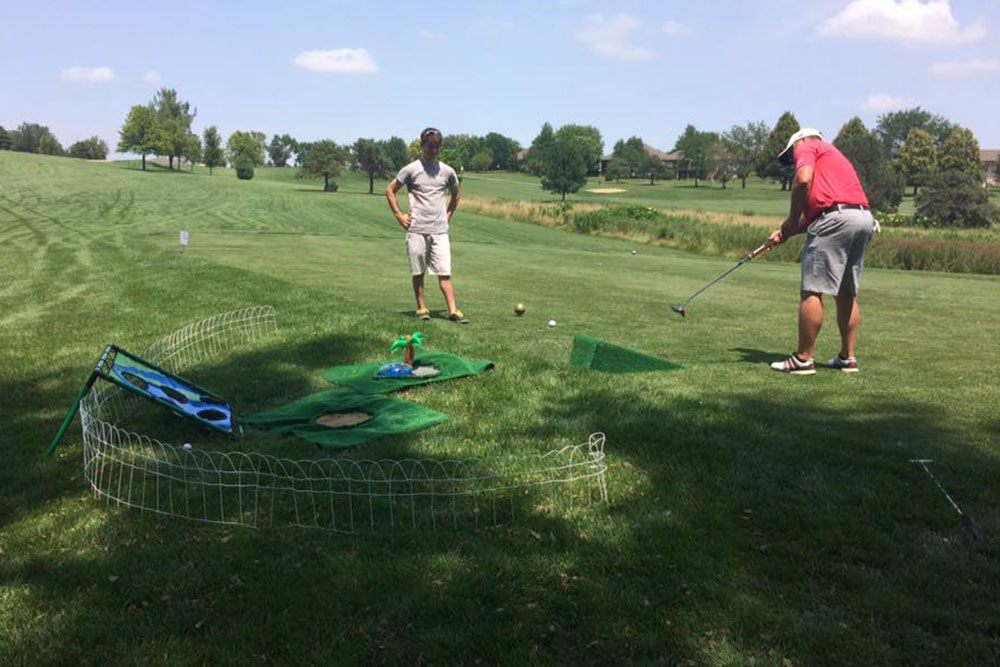 Student workers also supervised the sponsored competition holes, including the one where golfers tried to chip a ball into a net.