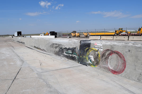 Chalk outlines show the places where the tires on an 80,000-pound tractor trailer collided with a concrete barrier during a test April 13 at the Midwest Roadside Safety Facility.