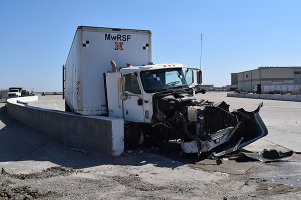 The engine of an 80,000-pound tractor-trailer was destroyed after the vehicle collided with a concrete barrier during a test April 13 at the Midwest Roadside Safety Facility.