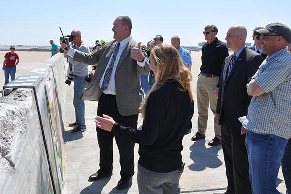 Ron Faller, director of the Midwest Roadside Safety Facility, reacts to the results of a crash test along with Jennifer Schmidt, Nebraska Gov. Pete Ricketts and Robert Bielenberg.