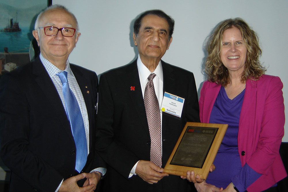 Hamid Vakilzadian (center), professor of electrical and computer engineering, was presented with the George F. McClure Citation of Honor at the IEEE-USA Awards and Recognitions Ceremony on Feb. 3 in Burlingame, Calif.