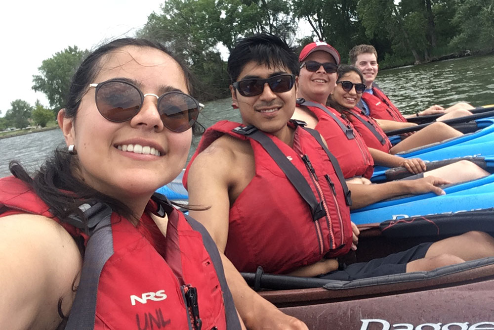 Yachay Tech students pause for a selfie during a kayaking adventure at a local lake.