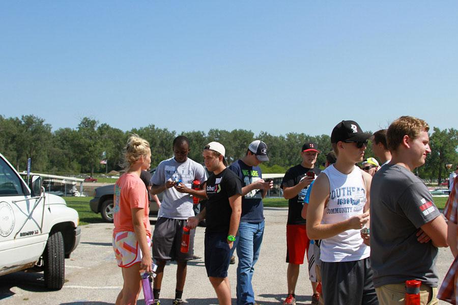 Students socialize after picking up trash