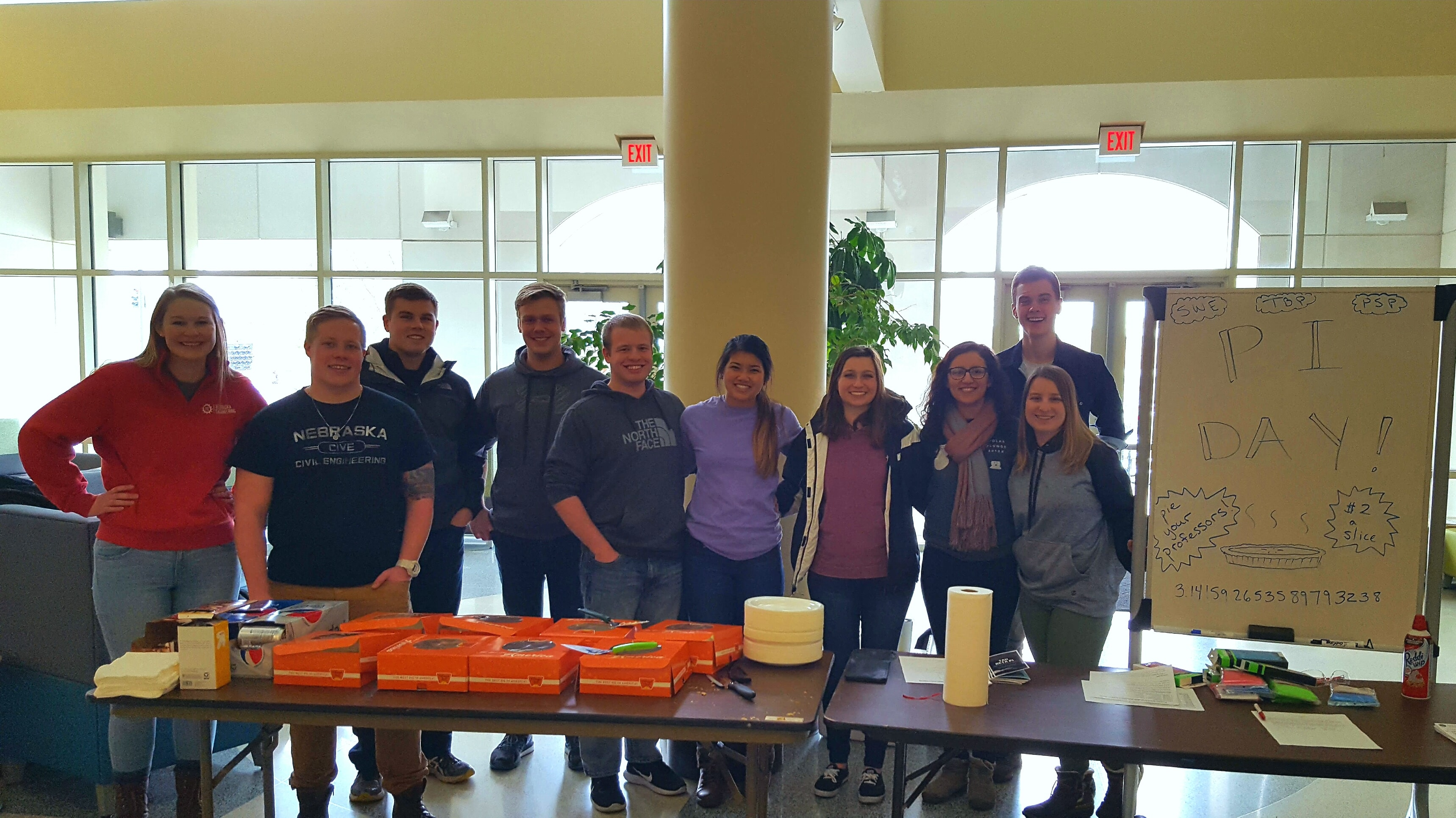 Several members volunteering to sell Pie on Pi Day