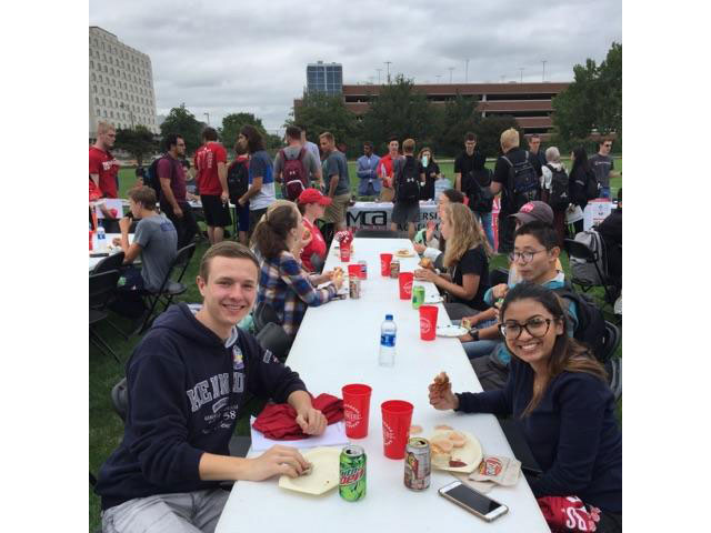 Eating dinner at Rock The Block + Engineering Student Organizations Fair