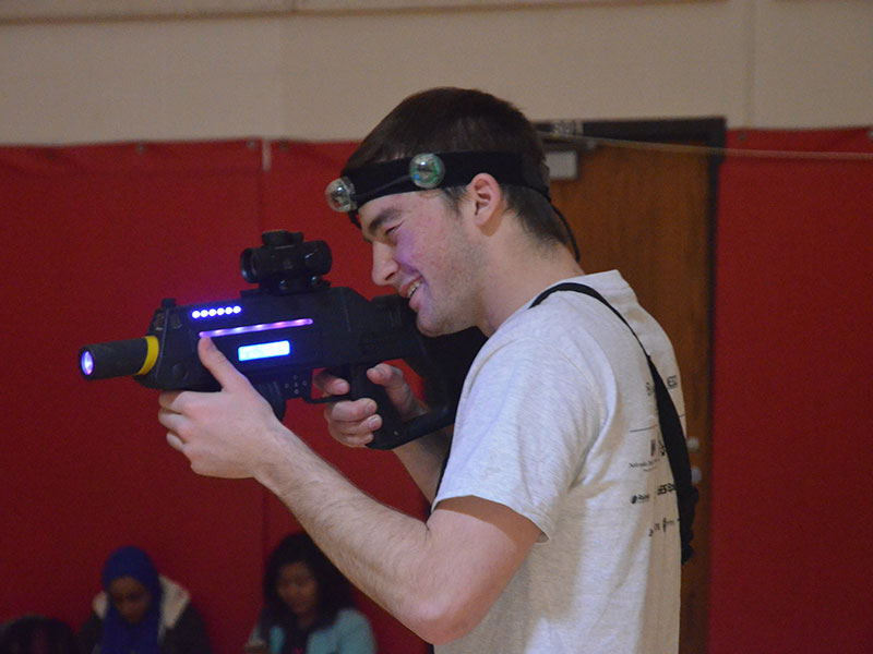 A student focuses in during a game of Laser Tag