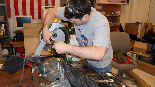Ethan Monhollon works on components for the frame assemblyto carry the 2014 UNL Microgravity Team project.