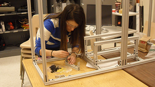 Effie Greene carries on frame assembly for the 2014 UNL Microgravity Team project.