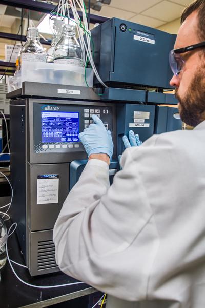 scientist at instrument panel
