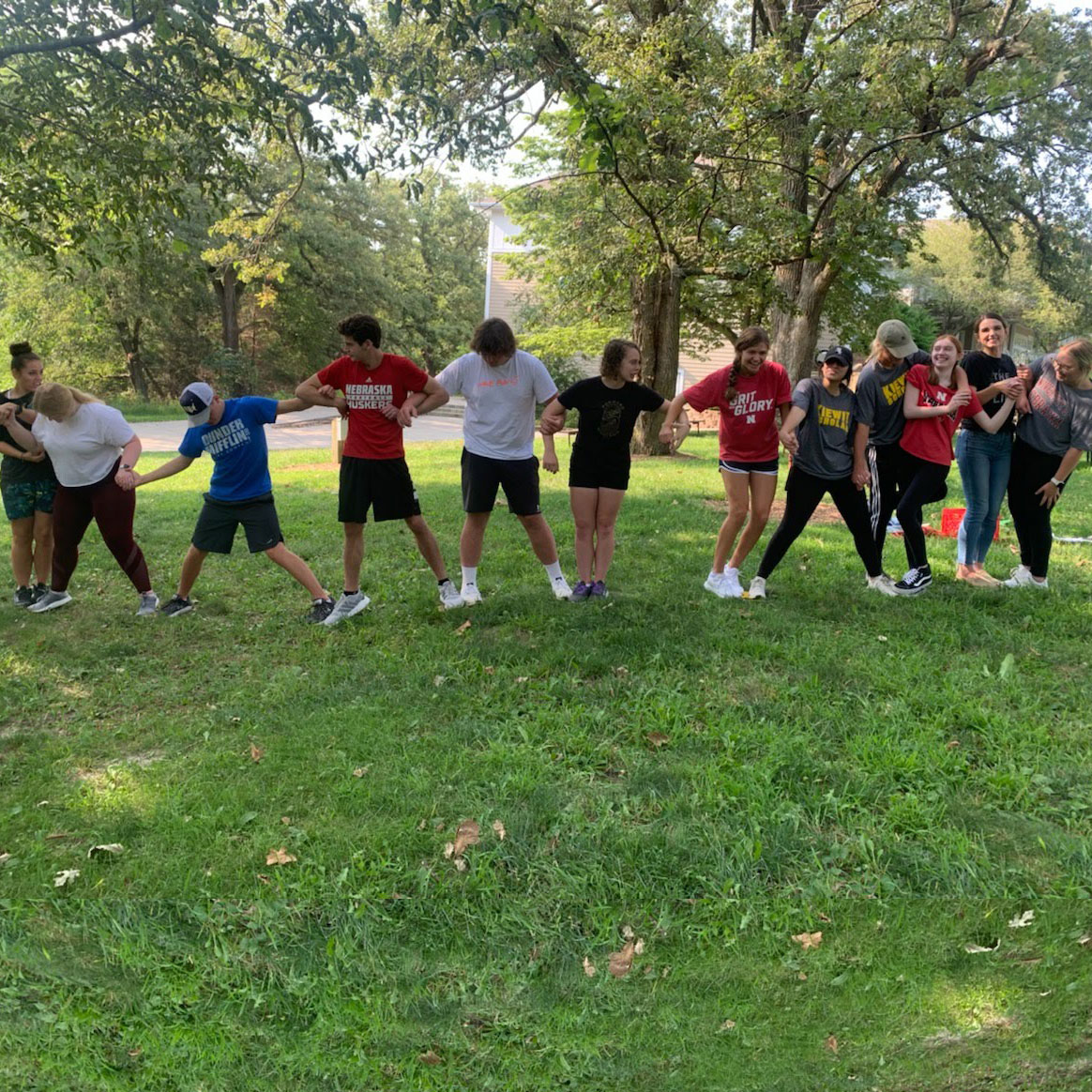 Kiewit Scholar group forming a human chain during a group activity.