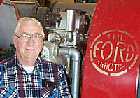 Dr. Bill Splinter with red Ford tractor