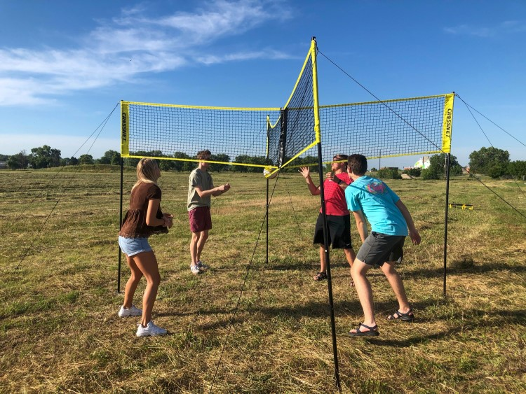 Interns from Spreetail play volleyball together