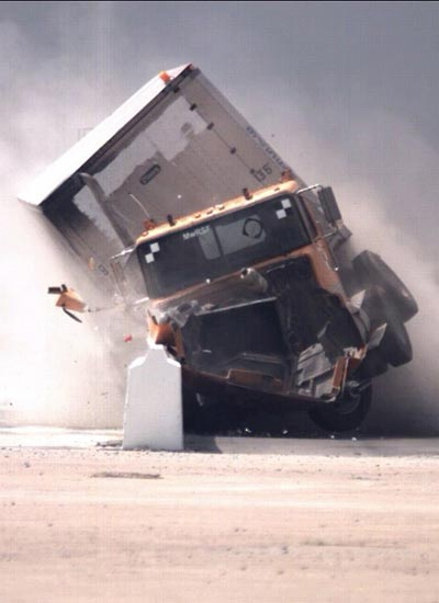 A truck crashes during a test at the Midwest Roadside Safety Facility in Lincoln, Nebraska.