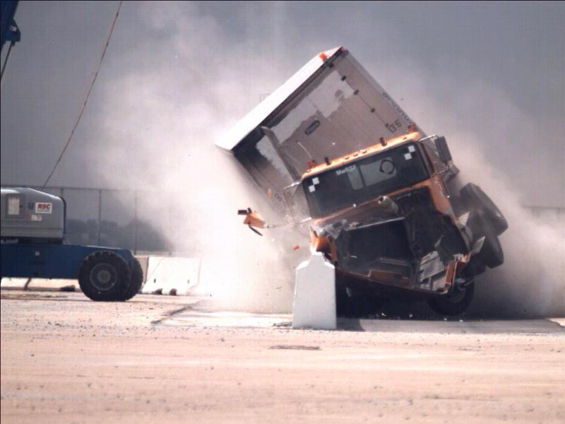 A truck crashes during a test at the Midwest Roadside Safety Facility.